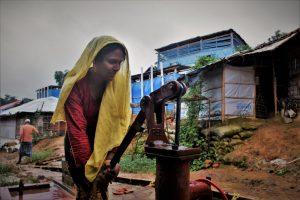 Rohingya refugee Ayesha collecting water for her family in Cox's Bazar, Bangladesh. Photo: Maruf Hasan/Oxfam